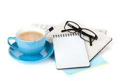Blue coffee cup, glasses and office supplies Stock Photos