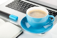 Blue coffee cup, laptop and office supplies Royalty Free Stock Image