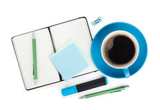 Blue coffee cup and office supplies Royalty Free Stock Photography