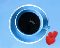 Blue coffee cup with small red hearts (Love concept) Stock Images
