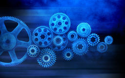 Blue Cogs Gears Business Background. A montage of connected industrial cogs or gears with a blue tone royalty free stock image