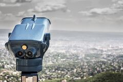Blue Coin Operated Binocular With City View during Daytime Stock Photography