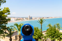Blue Coin Operated Telescope Of Panoramic Tropical City And Ocean Royalty Free Stock Photos
