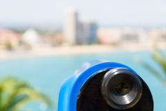 Blue Coin Operated Telescope Of Panoramic Tropical City And Ocean Stock Image
