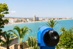 Blue Coin Operated Telescope Of Panoramic Tropical City And Ocean Stock Photography