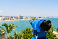 Blue Coin Operated Telescope Of Panoramic Tropical City And Ocean Stock Photo