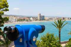 Blue Coin Operated Telescope Of Panoramic Tropical City And Ocean Stock Images