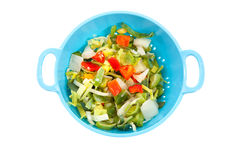 Blue colander with healthy vegetables Royalty Free Stock Photos