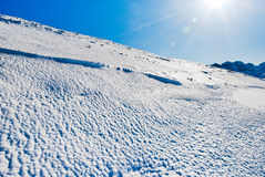Blue cold snow on Alps mountain Stock Photography