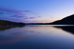 Blue cold sunrise over lake in sweden Royalty Free Stock Images