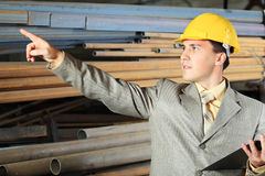 Blue collar. Industrial theme: a blue collar working at a manufacturing area stock photography