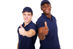 Blue collar co-workers. Two blue collar co-workers giving thumbs up stock image