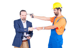 Blue collar laborer threating businessman for getting his euro money for services isolated on white background Royalty Free Stock Images