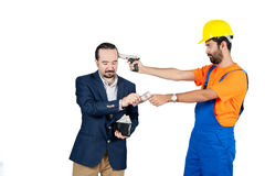 Blue collar laborer threating businessman for getting his money for services isolated on white background Stock Photos