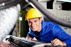 Blue collar worker. Happy modern blue collar worker in factory royalty free stock photo