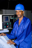Blue collar worker. African american blue collar worker at work stock photos