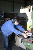 Blue collar worker in factory Royalty Free Stock Photo
