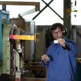 Blue collar worker in factory Royalty Free Stock Image