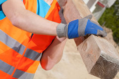 Free Blue-collar Worker Holding A Wooden Beam Stock Photos - 42766663