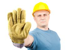 Blue Collar Worker Making Stop Sign Stock Photo