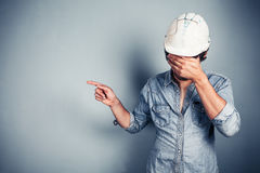 Blue collar worker pointing Royalty Free Stock Photography