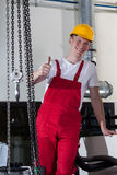 Blue-collar worker showing thumbs up sign Stock Photos