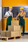 Blue-collar worker talking with his collaborator Royalty Free Stock Photography
