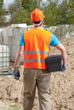 Blue-collar worker with toolbox and grout float Royalty Free Stock Images