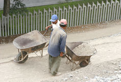 Blue Collar Workers. Workers in Peru moving dirt Stock Photos