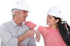Blue collar workers. Taking a break together Royalty Free Stock Image