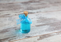 Blue cologne in glass bottle Royalty Free Stock Images