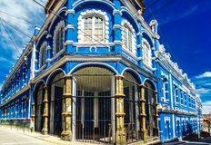 Blue colonial building in the old town of Bolivia stock image