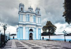 The blue colonial Santa Lucia church. San Cristobal de las Casas, Chiapas, Mexico. royalty free stock photo