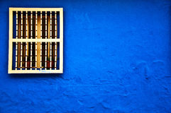 Blue Colonial Wall. A colonial styled window and wall in the historical center of Bogota, Colombia Stock Photos