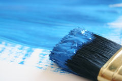 Blue color. Brush with blue color on its top stock photos