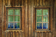 Blue color botles in old window Royalty Free Stock Images