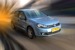 Blue color car on a blurred background. Royalty Free Stock Photos