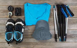 Blue color coordinated outdoor walking accessories on rustic woo Stock Image