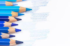Blue color crayons and drawn blue samples Royalty Free Stock Photos