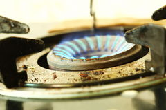 Blue color flame on stove. Stock Photos