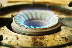 Blue color flame on stove. Royalty Free Stock Photos