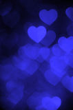 Blue color heart bokeh background photo. Abstract holiday, celebration backdrop. Royalty Free Stock Photos