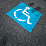 Blue color invalid parking sign Stock Images