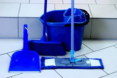 Blue color inventory for cleaning residential premises. stock photography