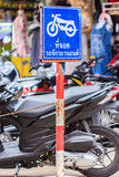 Blue color Motorcycle parking area sign against in thailand Stock Photo