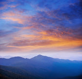 Blue color of mountains during sunset Stock Photo
