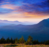 Blue color of mountains during sunset Royalty Free Stock Photos