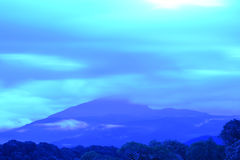 Blue color of mountains during sunset Royalty Free Stock Images