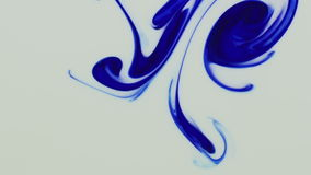 Blue color paint pouring in water stock video footage