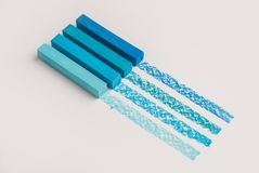 Blue color pastel crayon chalks over its own trace line Stock Photography